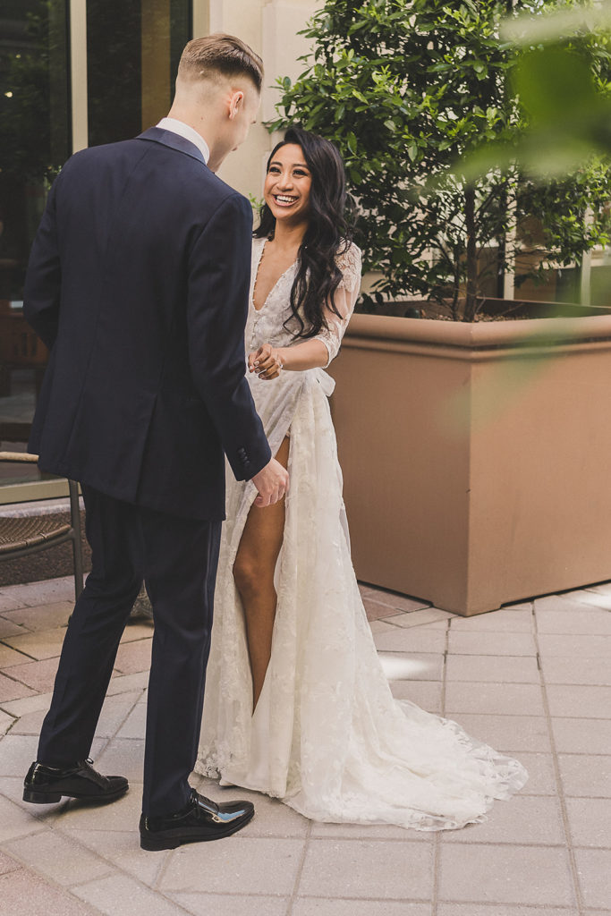 bride and groom smile during first look in Las Vegas with Taylor Made Photography