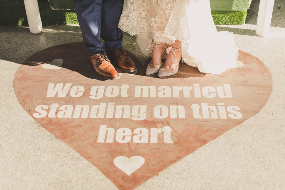 """bride and groom's toes and """"We Got Married Standing on This Heart"""" display photographed by Taylor Made Photography"""