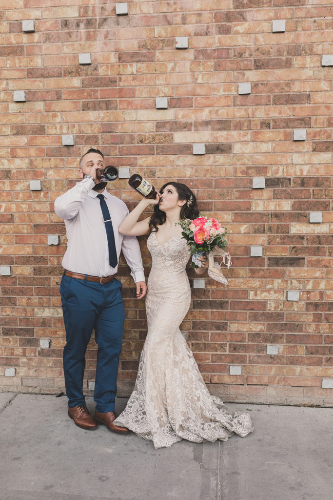 bride and groom drink beer in Las Vegas photographed by Taylor Made Photography