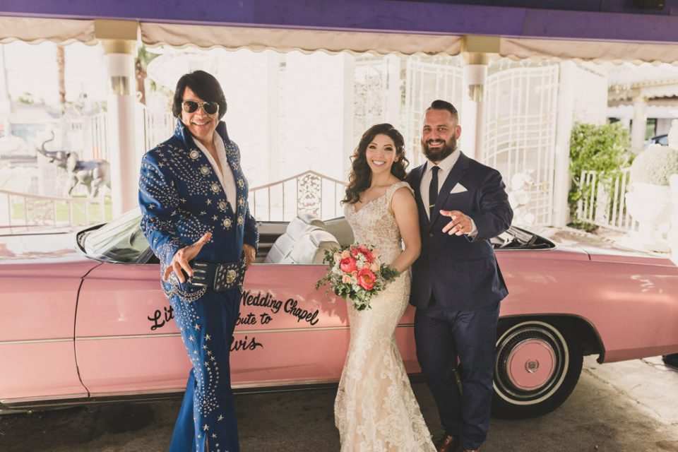 couple poses with Elvis at Little White Way Chapel after elopement photographed by Taylor Made Photography