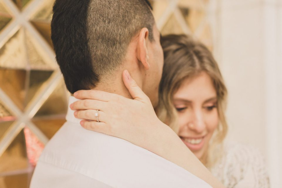 engagement portraits along Fremont Street buildings photographed by Taylor Made Photography