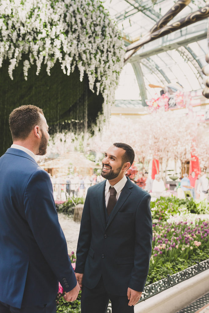 grooms laugh in Las Vegas garden during elopement with Taylor Made Photography
