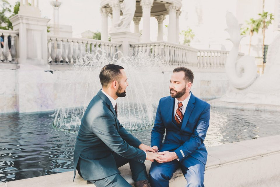 grooms talk by fountains in Caesar's Gardens