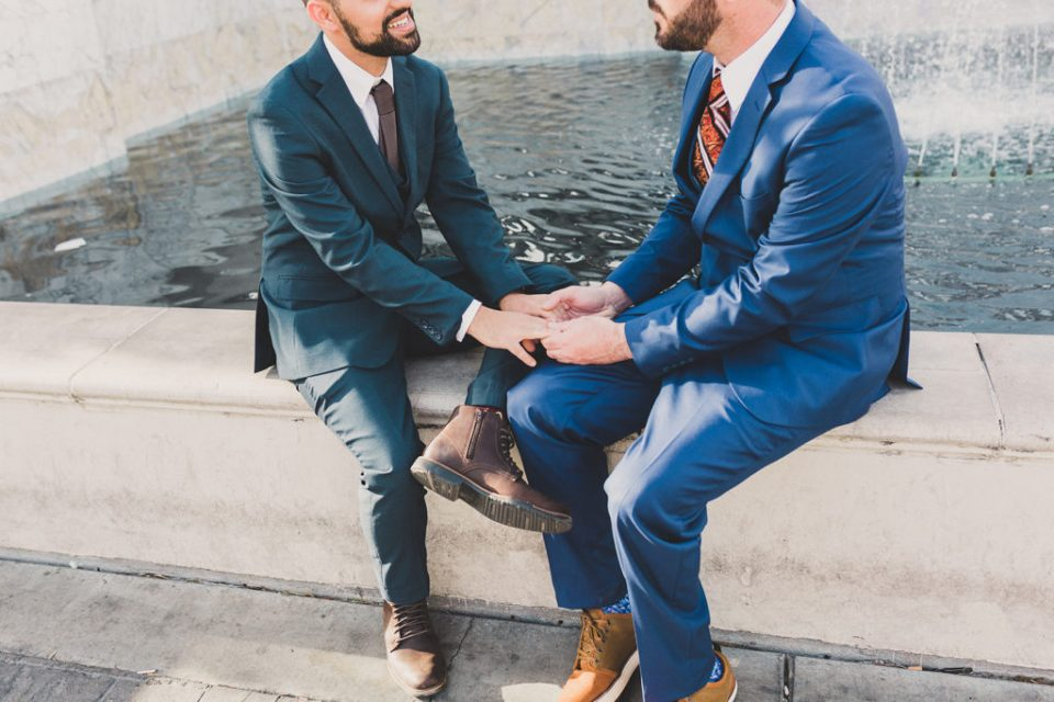 grooms pose at Caesars Fountain with Taylor Made Photography