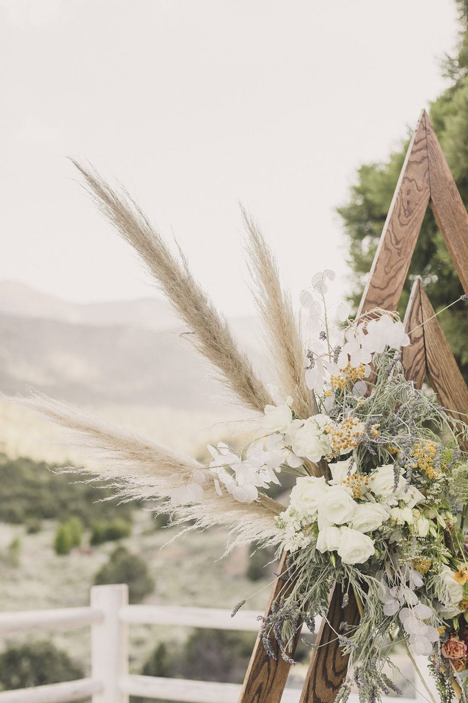 arbor details for modern triangle ceremony arch photographed by Taylor Made Photography