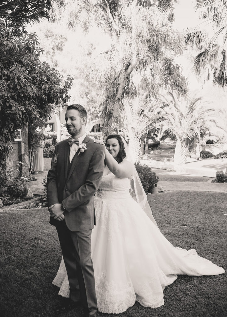 bride taps groom's shoulder for first look in Las Vegas photographed by Taylor Made Photography