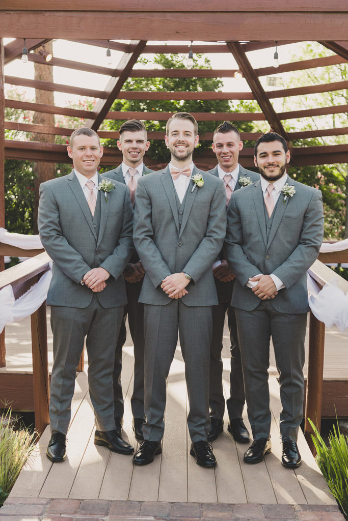 groomsmen pose by gazebo photographed by Taylor Made Photography