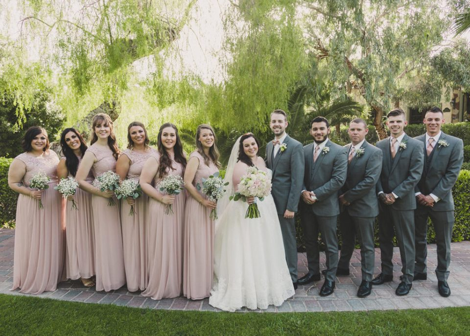 wedding party in pale pink and grey suits photographed by Taylor Made Photography