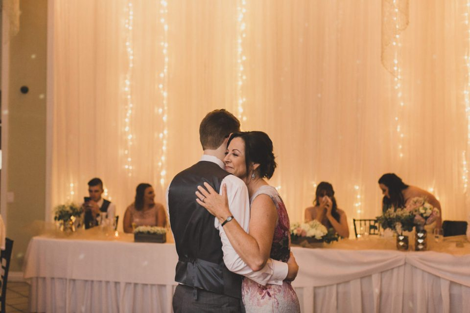 groom and mother dance during reception at The Grove photographed by  Taylor Made Photography