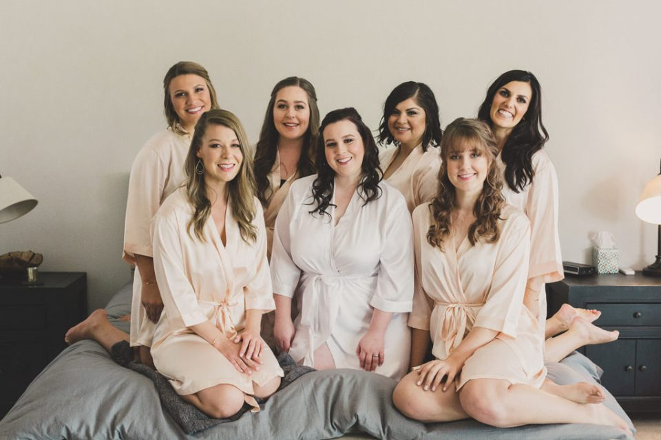 bride and bridesmaids pose photographed by Taylor Made Photography