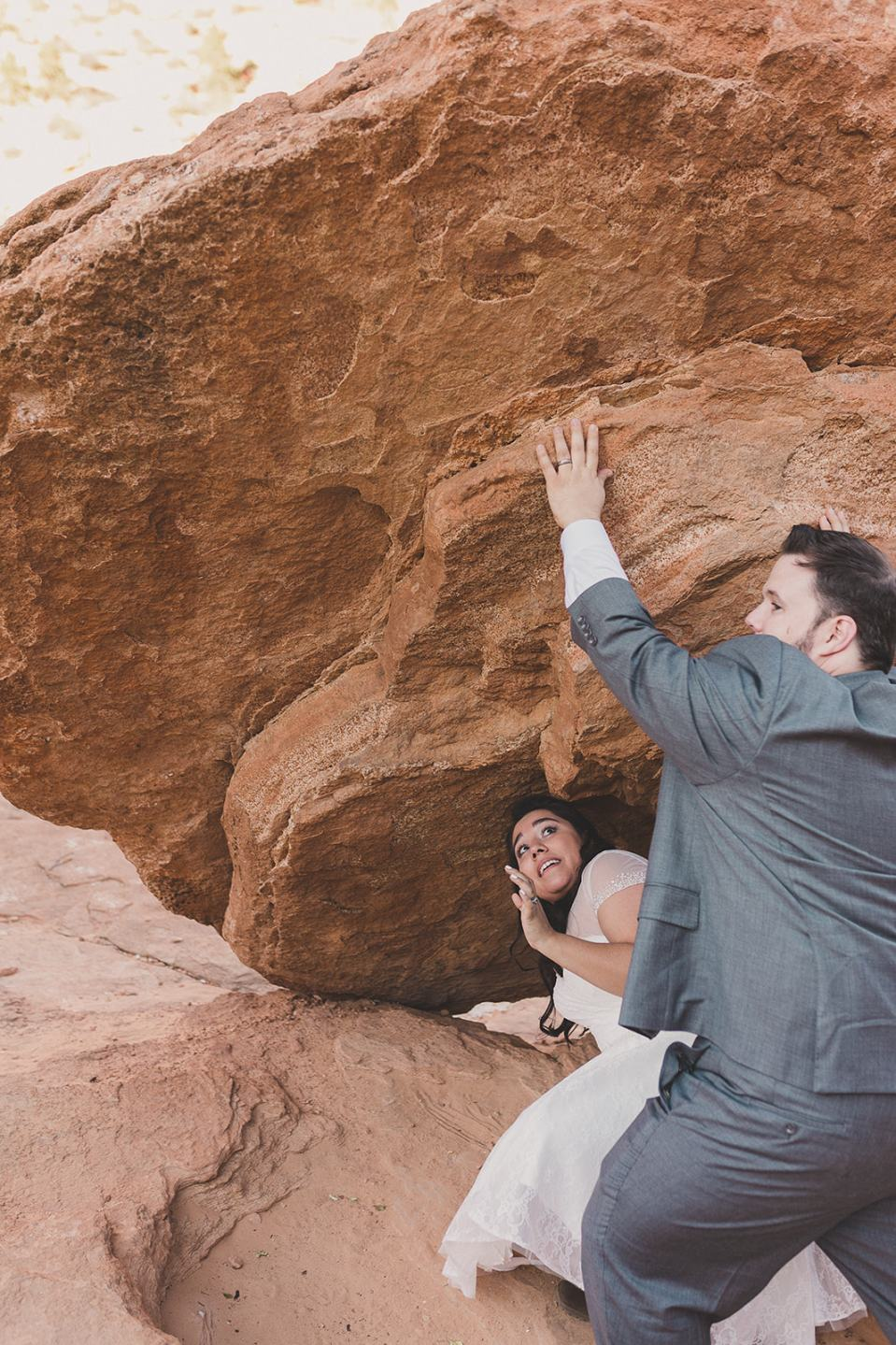 bride and groom pose for funny wedding portraits in Zion photographed by Taylor Made Photography