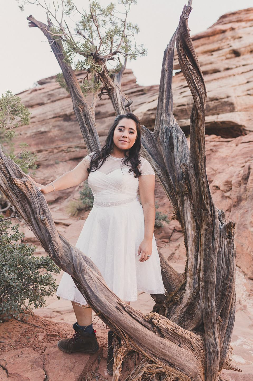 bride poses with trees in Zion National Park by Taylor Made Photography