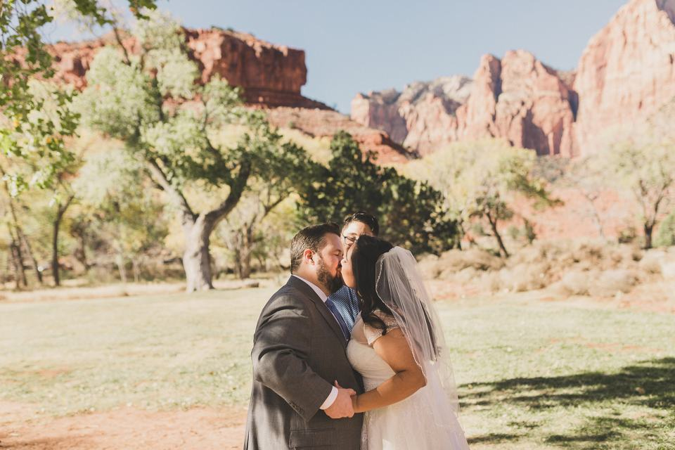 first kiss as husband and wife at Zion National Park wedding photographed by Taylor Made Photography