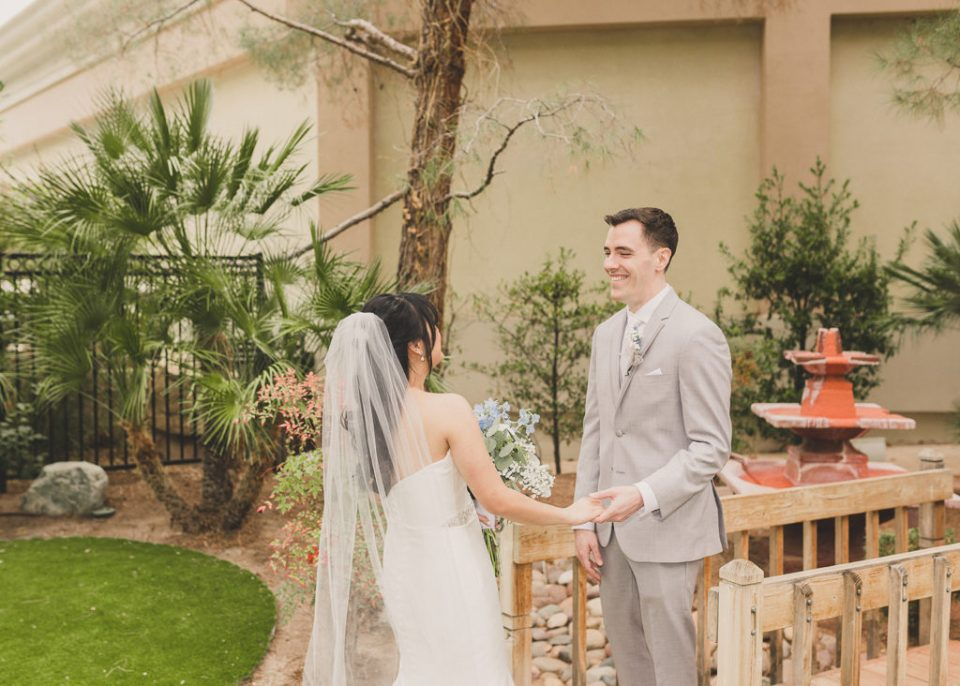 bride and groom smile during first look