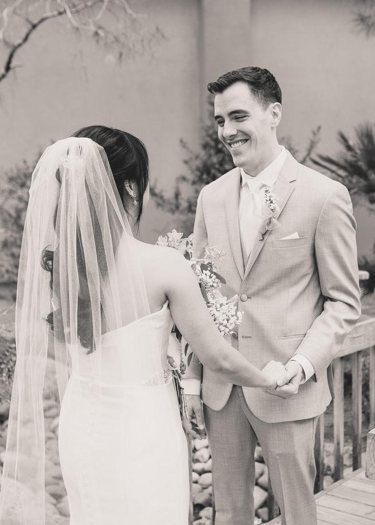 groom looks at bride during first look in Las Vegas