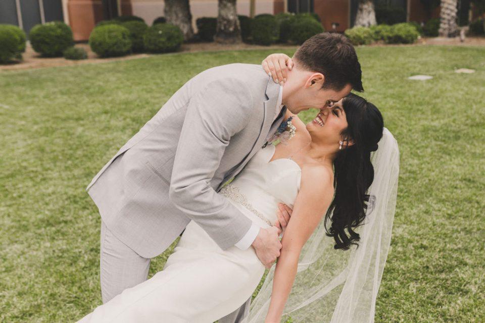 groom dips bride while nuzzling her nose at JW Marriott Las Vegas