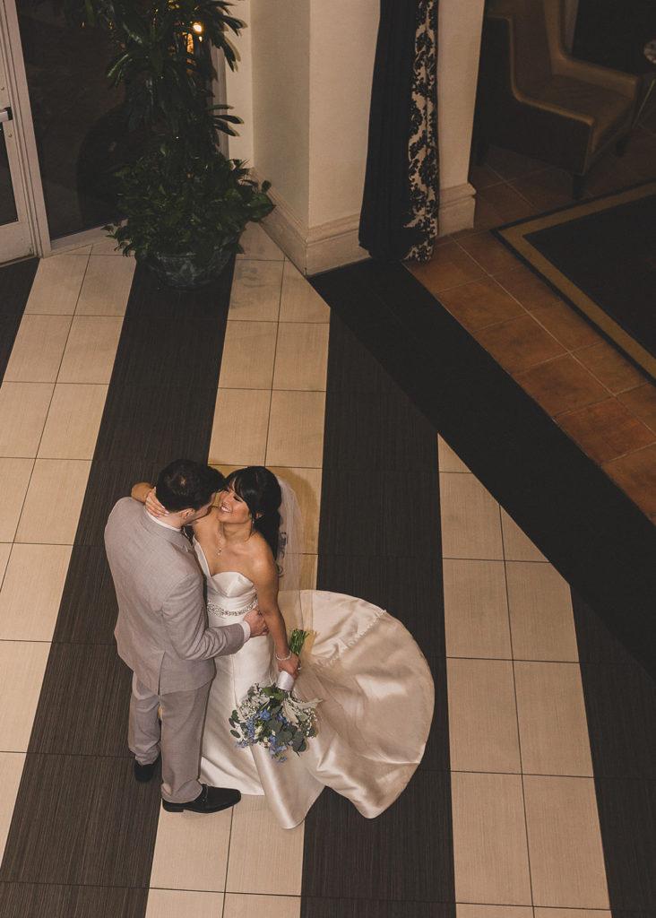 bride and groom in lobby of JW Marriott Las Vegas