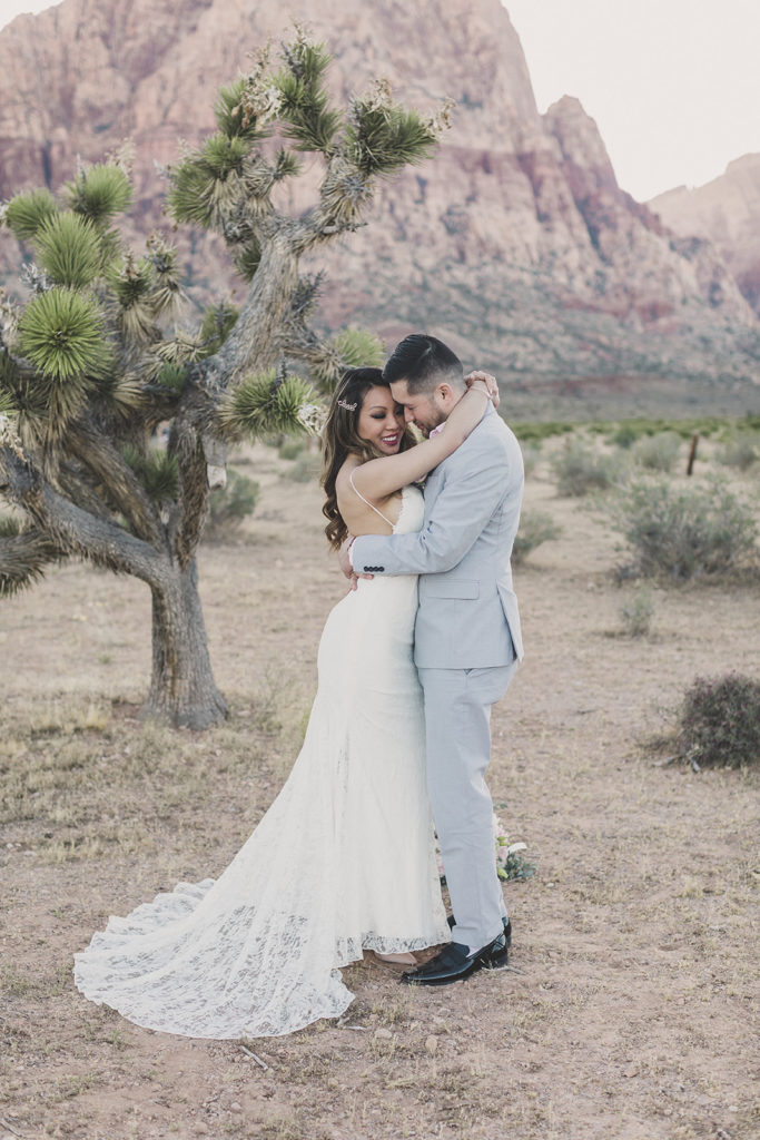 bride and groom hug during Las Vegas wedding portraits