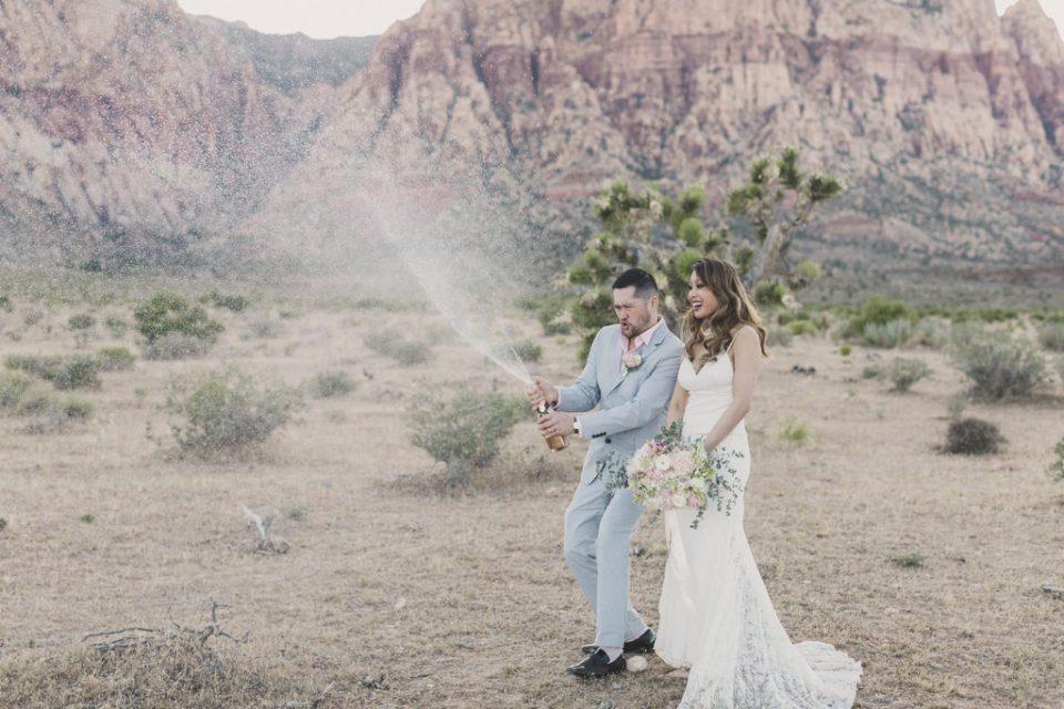 groom sprays champagne during elopement in Las Vegas