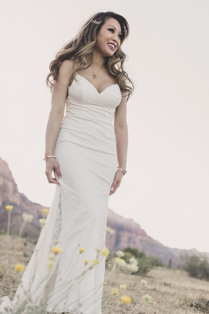 bride looks over Red Rock Canyon before elopement