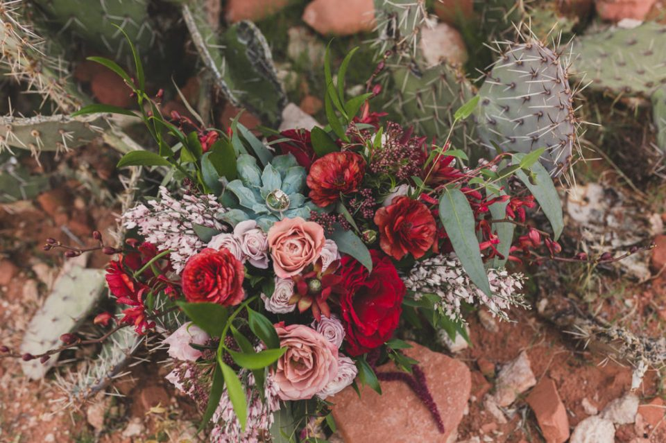 red and pink wedding bouquet photographed by Taylor Made Photography