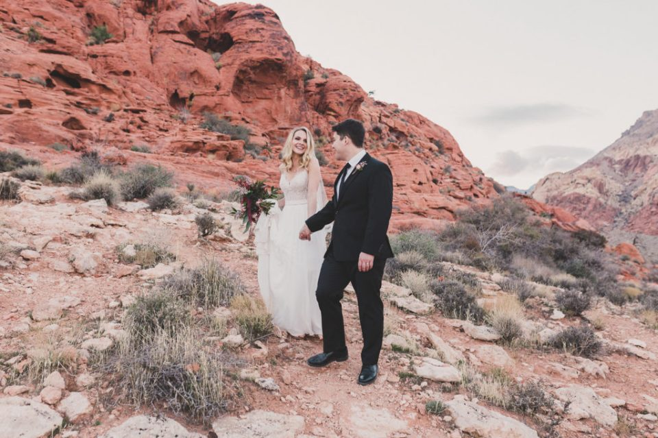 bride and groom walk through Red Rock Canyon with Taylor Made Photography