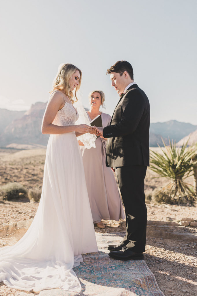bride and groom exchange rings in Las Vegas