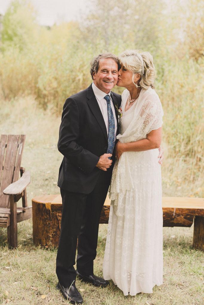 bride kisses groom on the cheek before Utah Wedding day