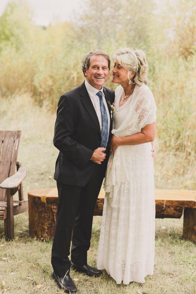 bride smiles with groom before Utah wedding