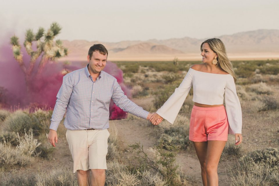 couple walks through desert at Seven Magic Mountains