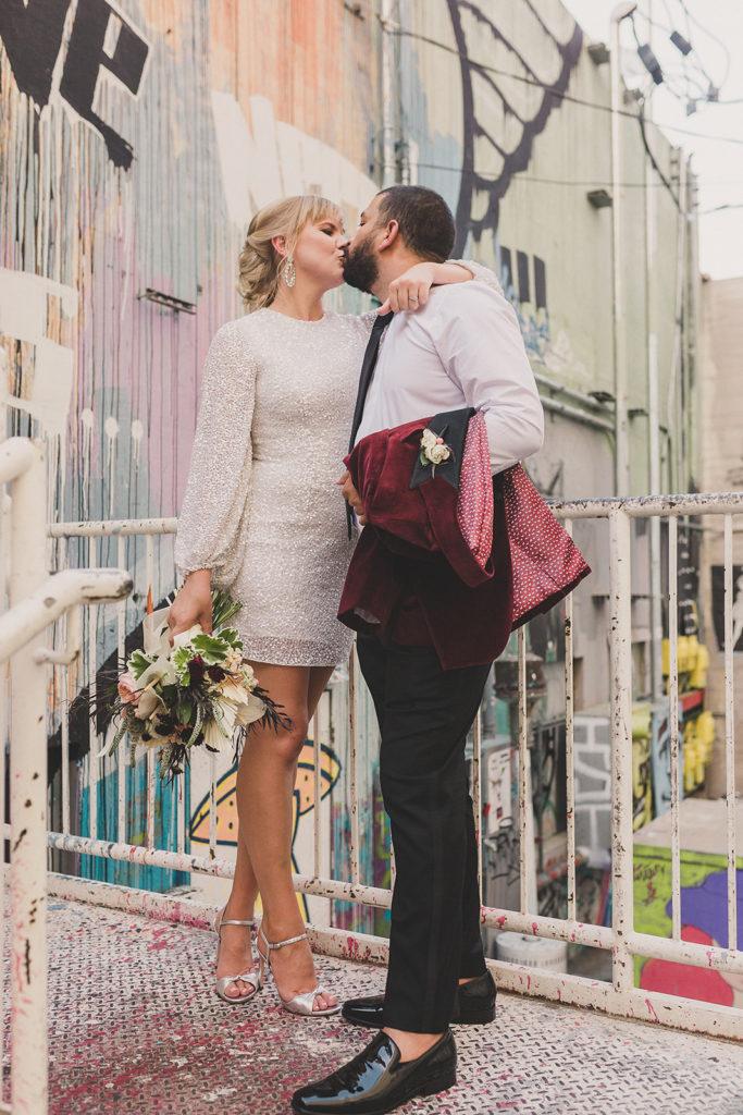 bride and groom kiss before Red Rock Resort elopement