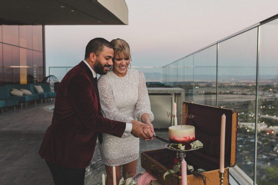 newlyweds cut cake in Las Vegas