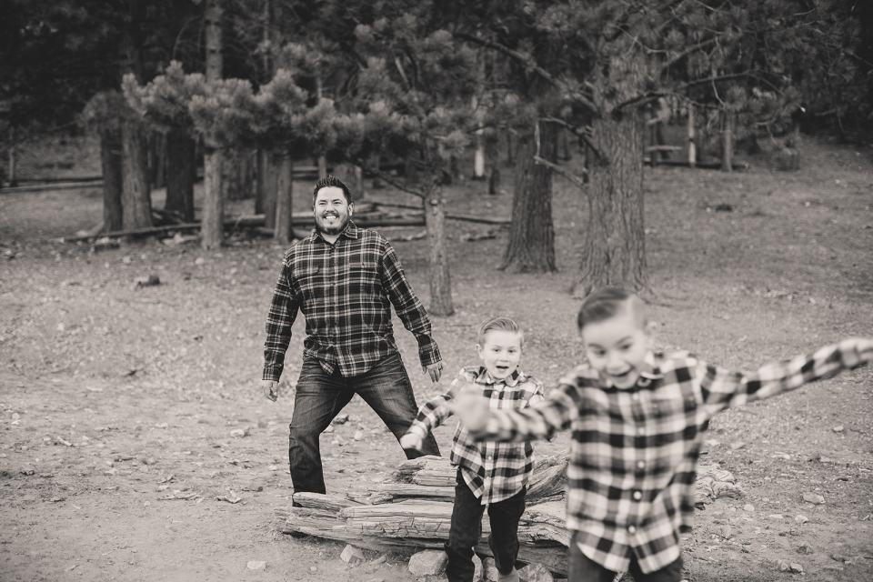 boys play with dad during family photos