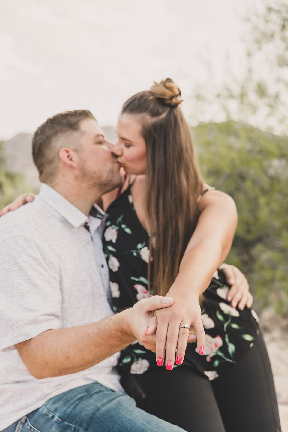 engaged couple kisses in Las Vegas desert after proposal