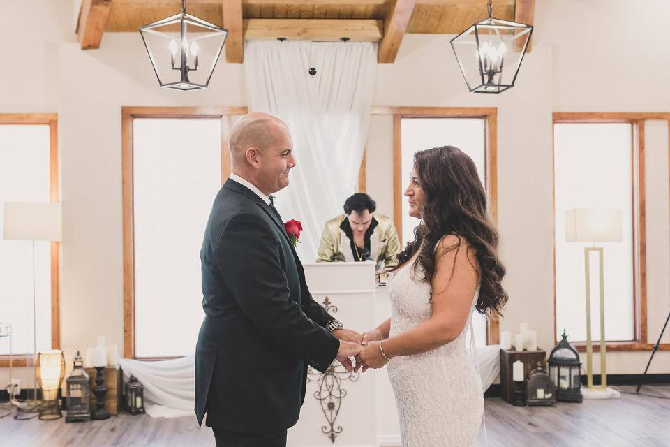 bride and groom exchange vows during Little Vegas Chapel Elopement