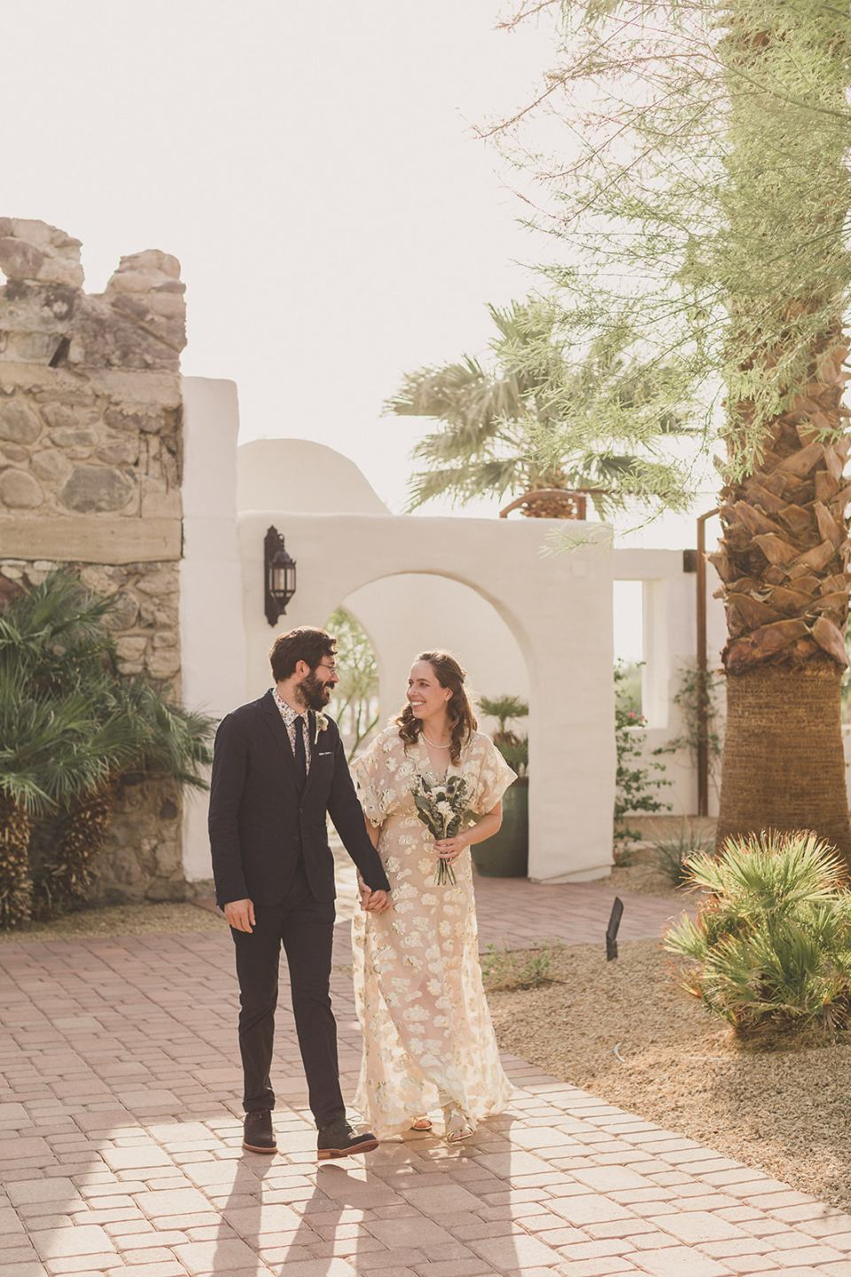 bride and groom walk together at the Oasis in Death Valley
