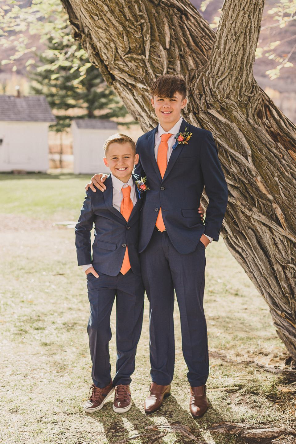 sons pose together in navy suits before elopement