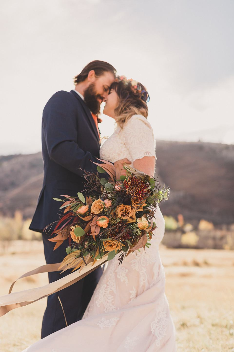 bride and groom stand together showing off bouquet after Park City elopement