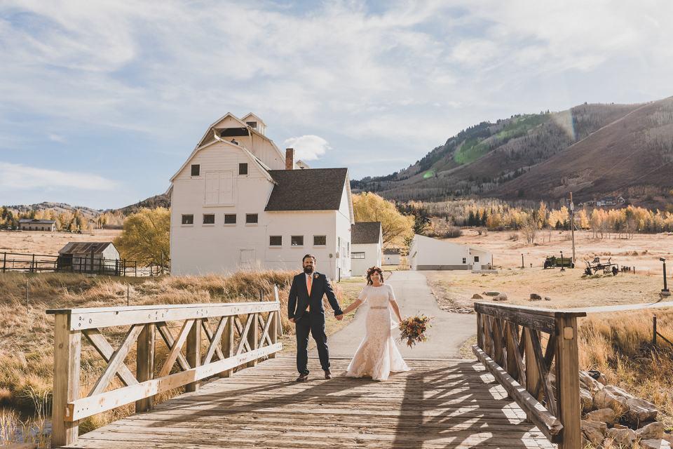 newlyweds pose on bridge in Utah