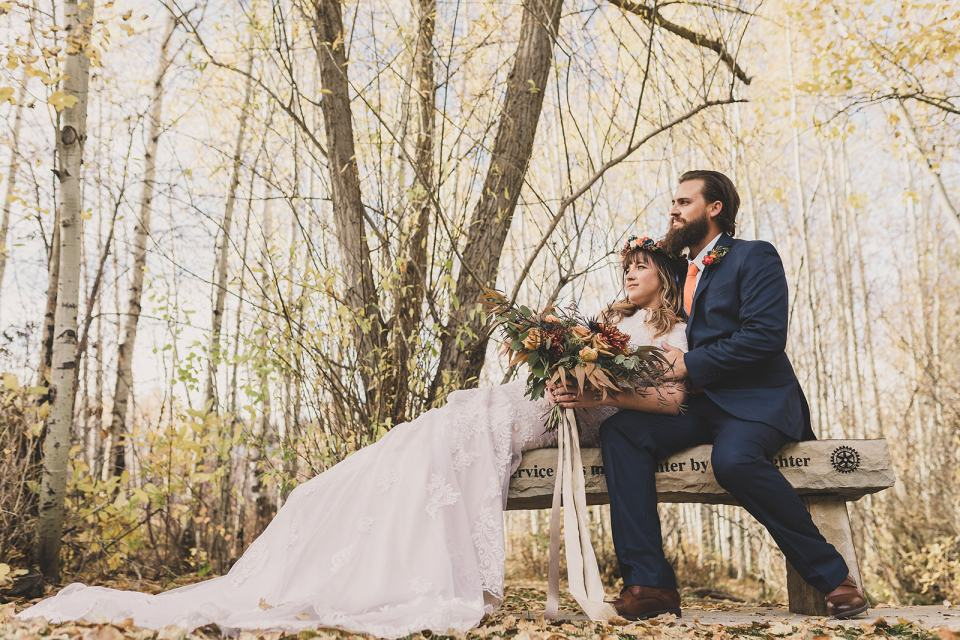 bride and groom relax on bench after Park City elopement