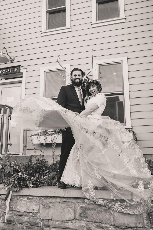 bride twirls wedding gown during Park City elopement photos