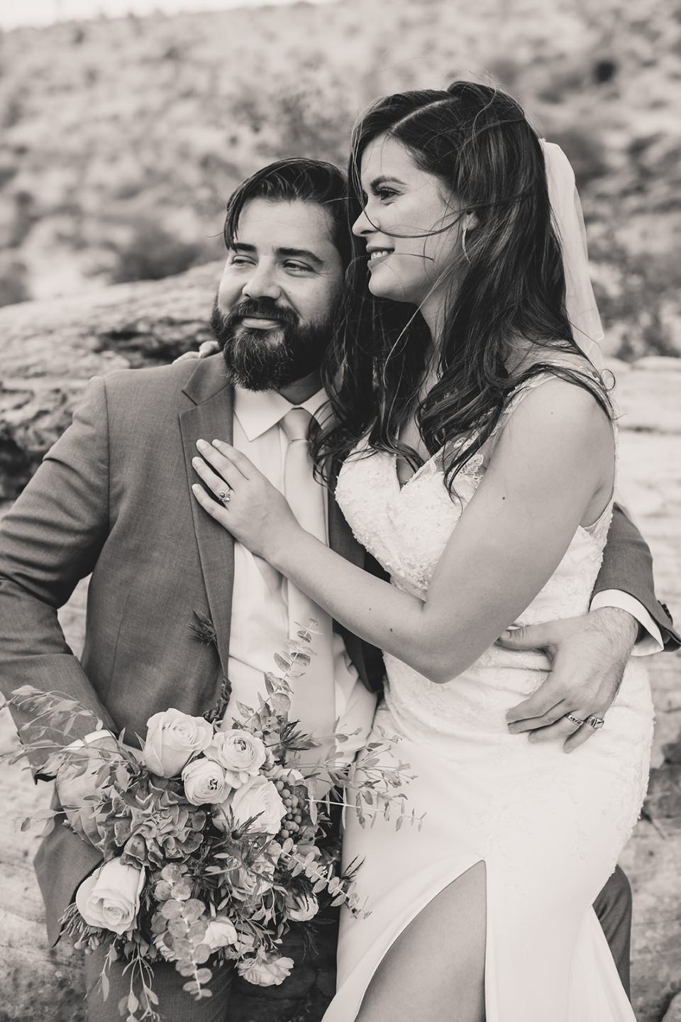 bride and groom sit in Red Rock Canyon together