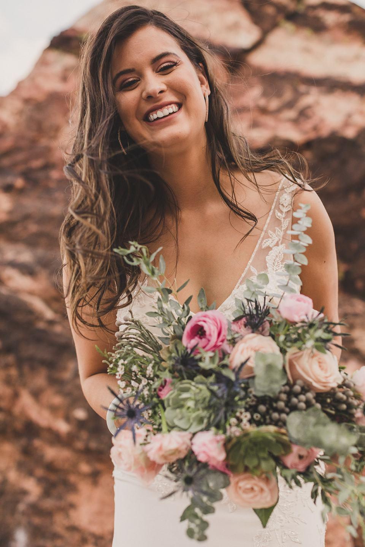 bride laughs during Red Spring Boardwalk Elopement portraits