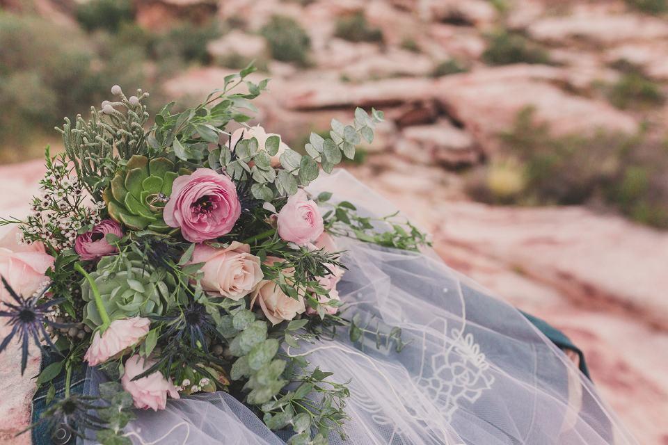 bride's bouquet with succulents rests on veil