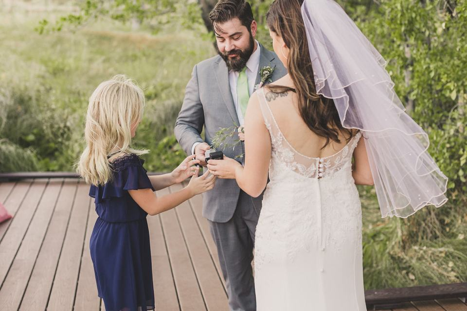 daughter brings up ring box during Red Spring Boardwalk Elopement