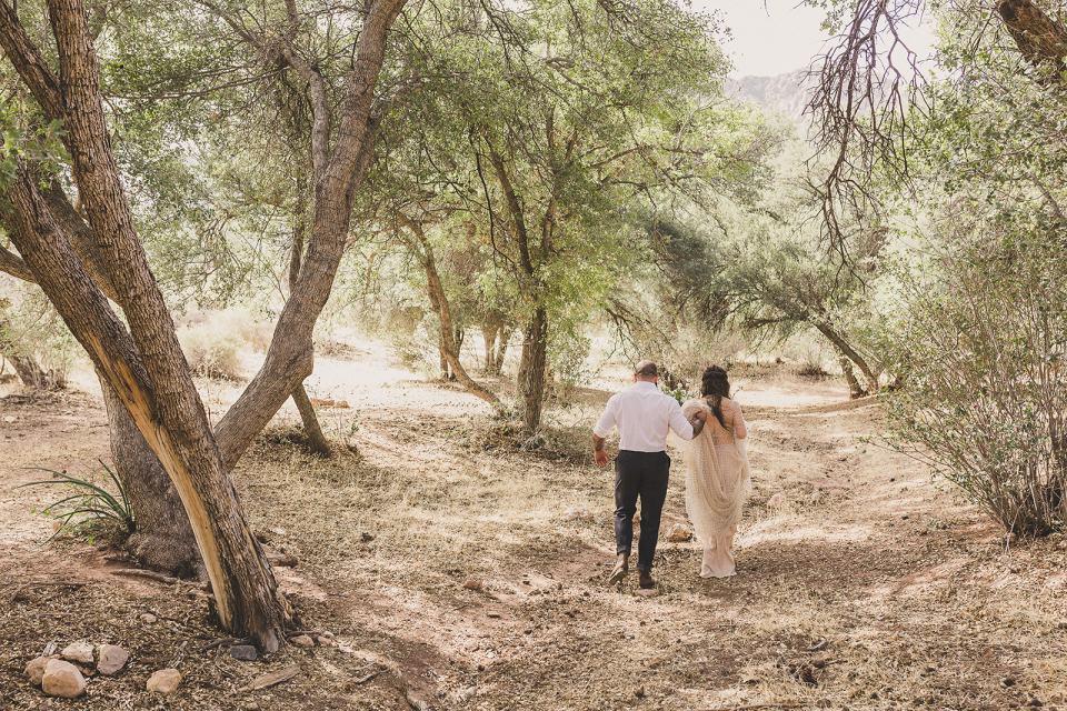 bride and groom walk through Spring Mountain Ranch