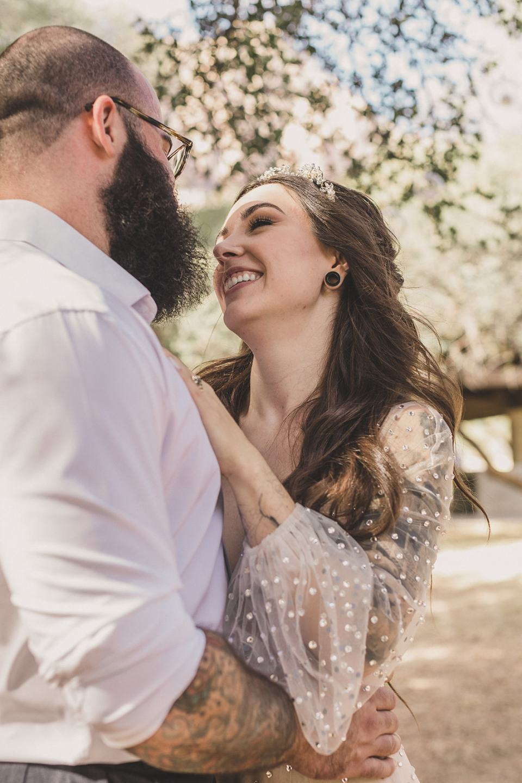 bride laughs during wedding photos in Las Vegas