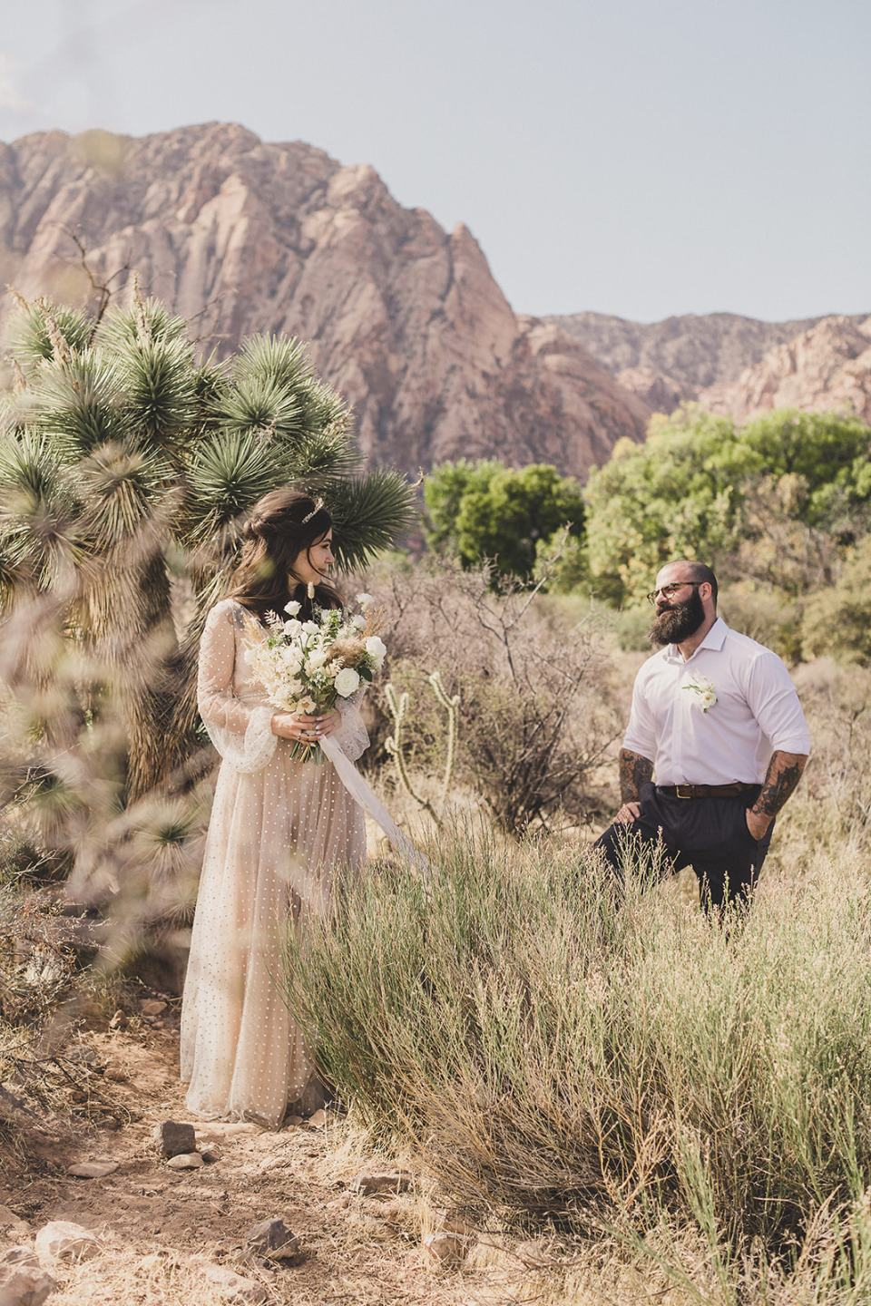 bride and groom pose in mountains of Las Vegas