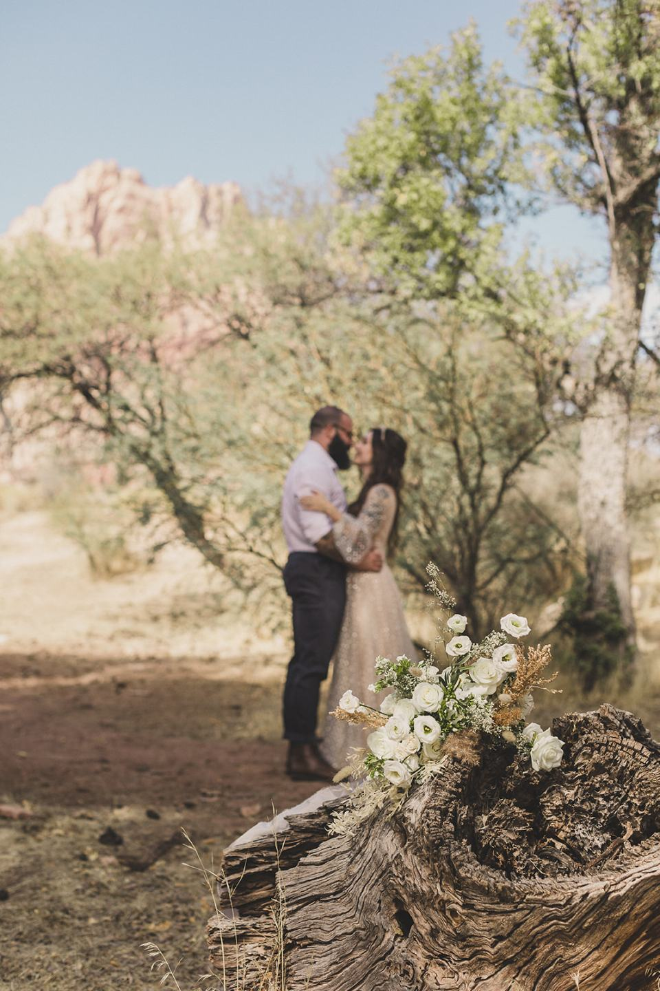 bride and groom kiss after Spring Mountain Ranch Elopement