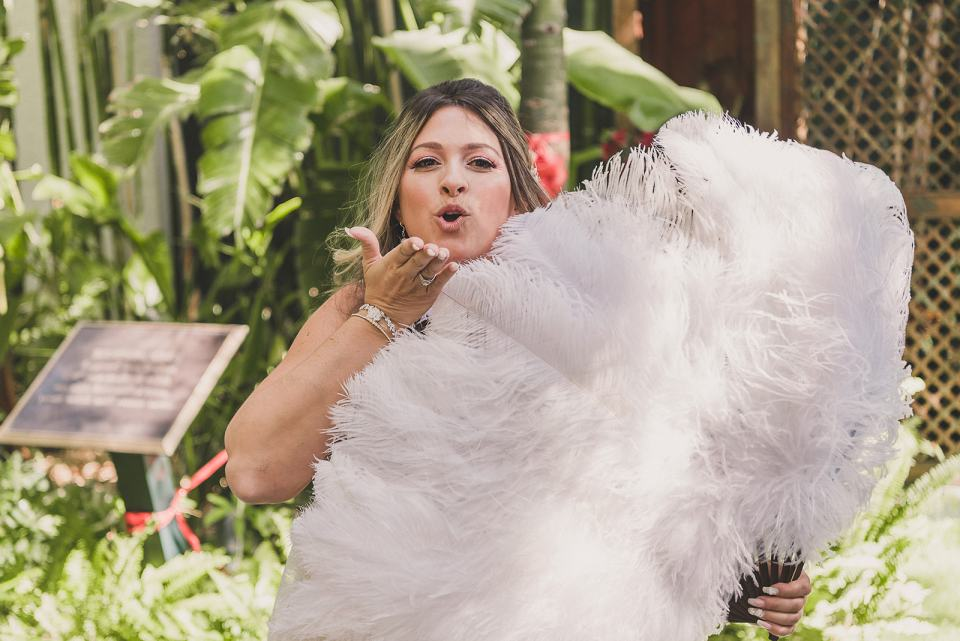 bride blows kiss over feather fan during Las Vegas first look